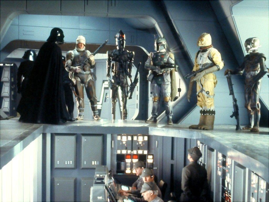 Cena de O Império Contra Ataca onde Boba Fett aparece ao lado do dróide assassino IG-88, mesmo modelo do IG-11 que aparece em The Mandalorian