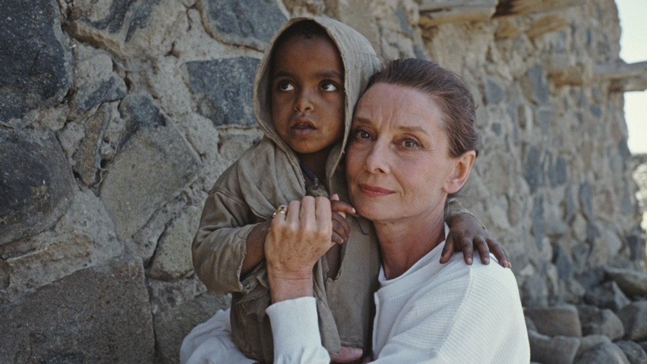 British actress and humanitarian Audrey Hepburn (1929 – 1993) with an Ethiopian girl on her first field mission for UNICEF in Ethiopia, 16th-17th March 1988. (Photo by Derek Hudson/Getty Images)